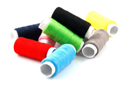 Set of colorful spools of thread isolated on white background photo