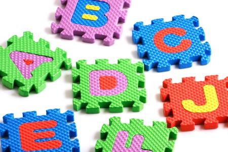Alphabet puzzle pieces on white background Stock Photo - 8293253