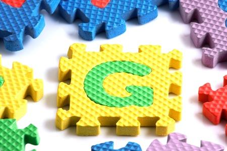 Alphabet puzzle pieces on white background Stock Photo - 8293241