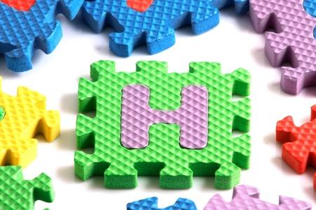 Alphabet puzzle pieces on white background Stock Photo - 8293250