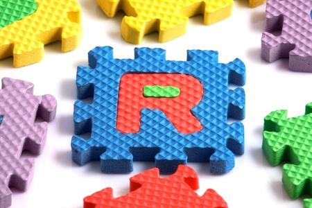 Alphabet puzzle pieces on white background Stock Photo - 8293249