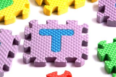 Alphabet puzzle pieces on white background Stock Photo - 8293229