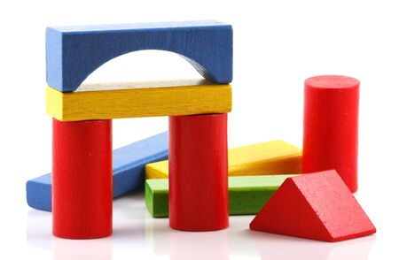 building blocks: Wooden building blocks on white background Stock Photo