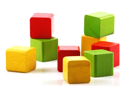 Wooden building blocks on white background photo