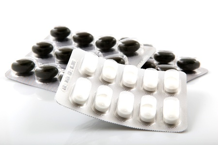 Packs of pills on white background photo