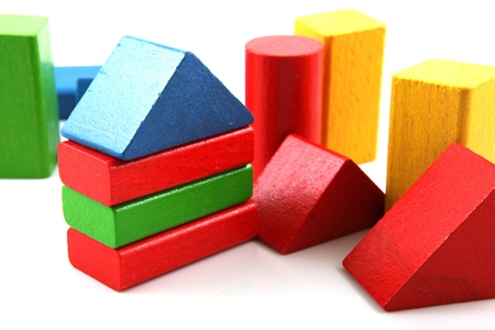 Wooden building blocks on white background photo