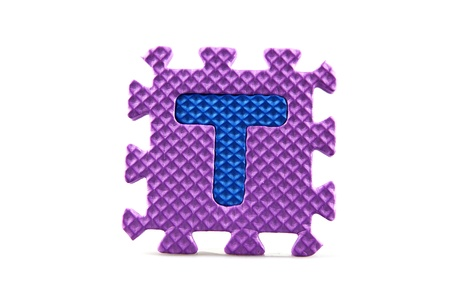 Alphabet puzzle pieces on white background Stock Photo - 8516569