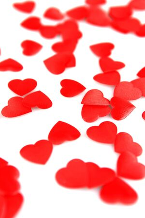 Red hearts confetti on white background photo