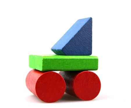 building blocks: Wooden building blocks on white background Stock Photo