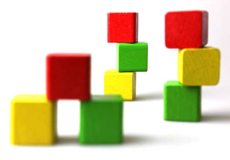 colored play: Colorful wooden blocks on white background