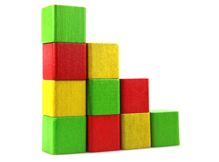 babes: Wooden building blocks on white background Stock Photo