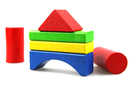 yellow block: Wooden building blocks on white background Stock Photo