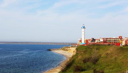 Beautiful lighthouse on sea coast photo