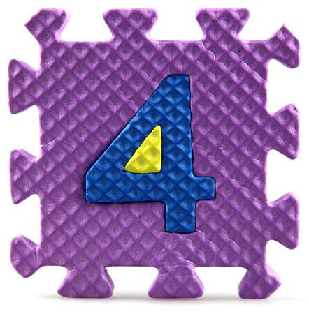 Alphabet puzzle pieces on white background Stock Photo - 9758934