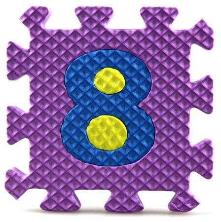 Alphabet puzzle pieces on white background Stock Photo - 9758932