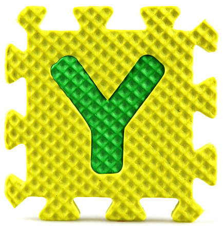 Alphabet puzzle pieces on white background Stock Photo - 9758954