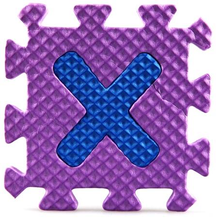 Alphabet puzzle pieces on white background photo