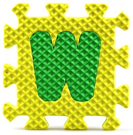 Alphabet puzzle pieces on white background Stock Photo - 9758942