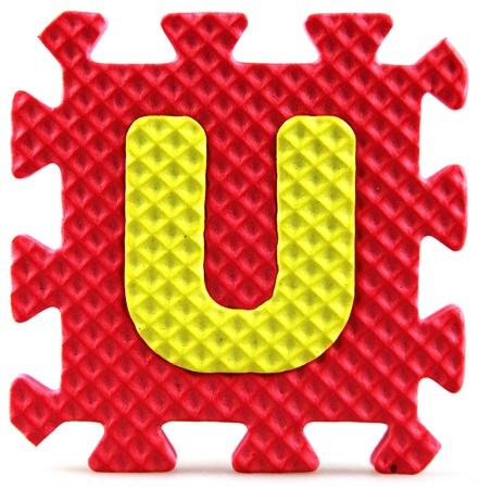 Alphabet puzzle pieces on white background Stock Photo - 9758910