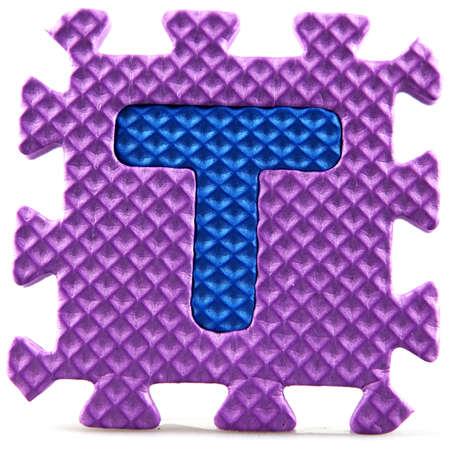 Alphabet puzzle pieces on white background Stock Photo - 9758950