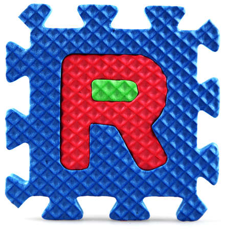 Alphabet puzzle pieces on white background Stock Photo - 9758915