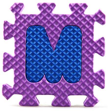 Alphabet puzzle pieces on white background Stock Photo - 9758949