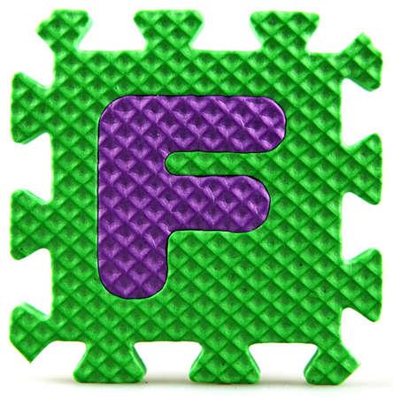 Alphabet puzzle pieces on white background Stock Photo - 9758956