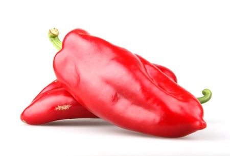 weight reduction plan: Red chilli peppers on white background