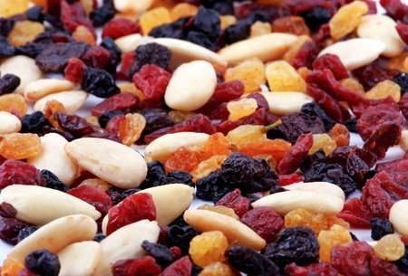 Dried fruits and nuts collection on a white background photo