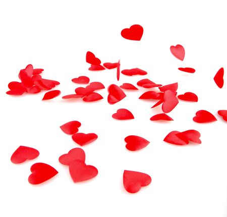 valentin day: Red hearts confetti on white background