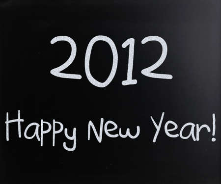 Happy New Year handwritten with white chalk on a blackboard photo