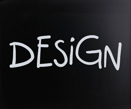 The word Design handwritten with white chalk on a blackboard photo