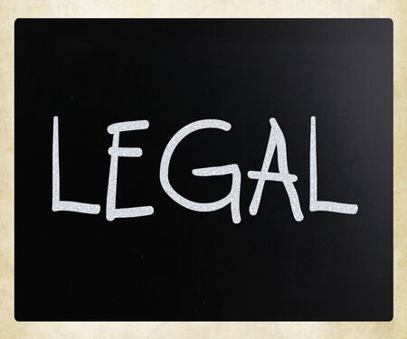 lawful: The word Legal handwritten with white chalk on a blackboard