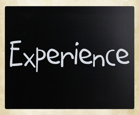The word Experience handwritten with white chalk on a blackboard photo