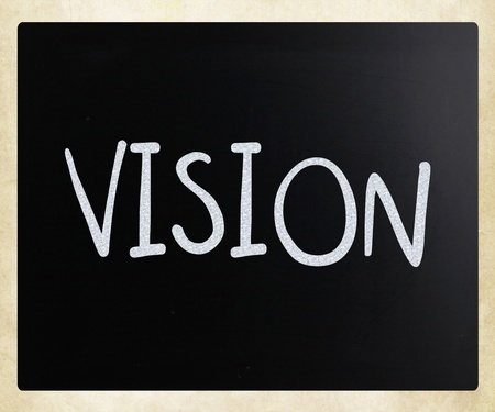 """dichiarazione: """"Vision"""" scritto a mano con il gesso bianco su una lavagna Archivio Fotografico"""