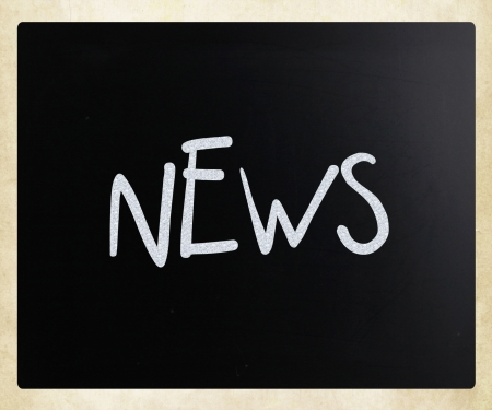 The word 'News' handwritten with white chalk on a blackboard photo