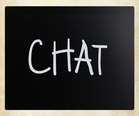 The word Chat handwritten with white chalk on a blackboard photo