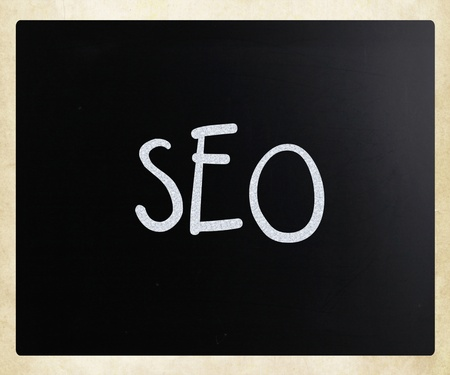 alexa: The word SEO handwritten with white chalk on a blackboard