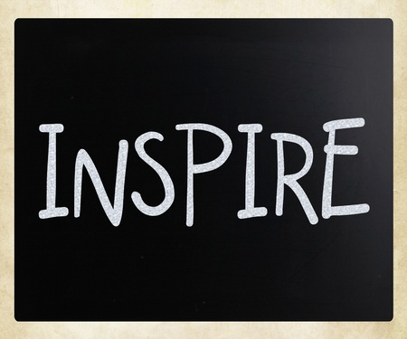 Inspire handwritten with white chalk on a blackboard photo