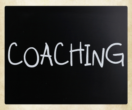 Coaching handwritten with white chalk on a blackboard