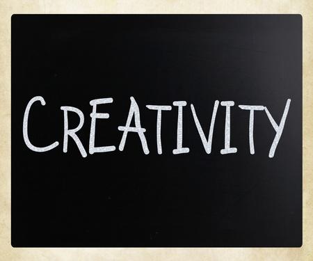 The word Creativity handwritten with white chalk on a blackboard photo