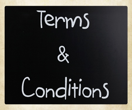 terms: Terms & Conditions handwritten with white chalk on a blackboard Stock Photo