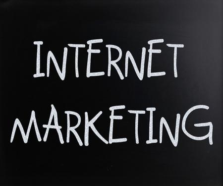 Internet marketing handwritten with white chalk on a blackboard photo