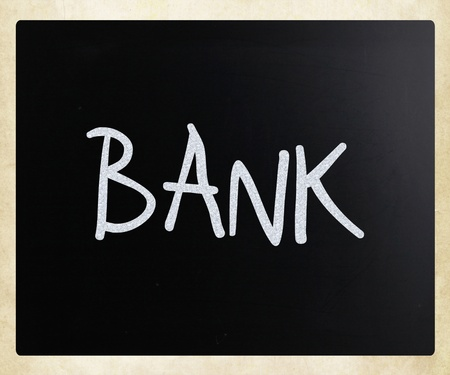 The word Bank handwritten with white chalk on a blackboard photo