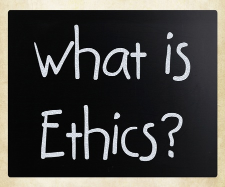 What is Ethics? handwritten with white chalk on a blackboard photo