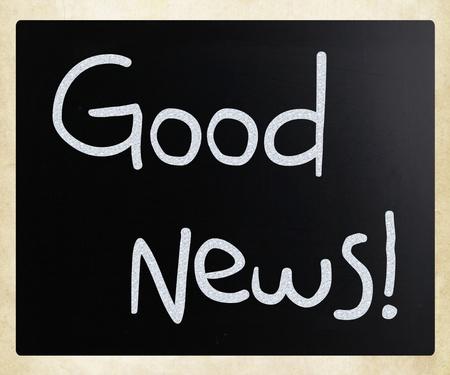 Good News! handwritten with white chalk on a blackboard