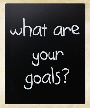 What are your goals? handwritten with white chalk on a blackboard photo