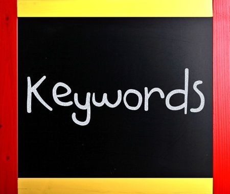 meta tags: The word Keywords handwritten with white chalk on a blackboard
