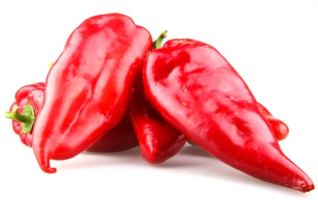 weight reduction plan: Red chilli peppers on white background.