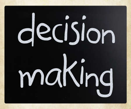 making decision:  Decision making  handwritten with white chalk on a blackboard Stock Photo